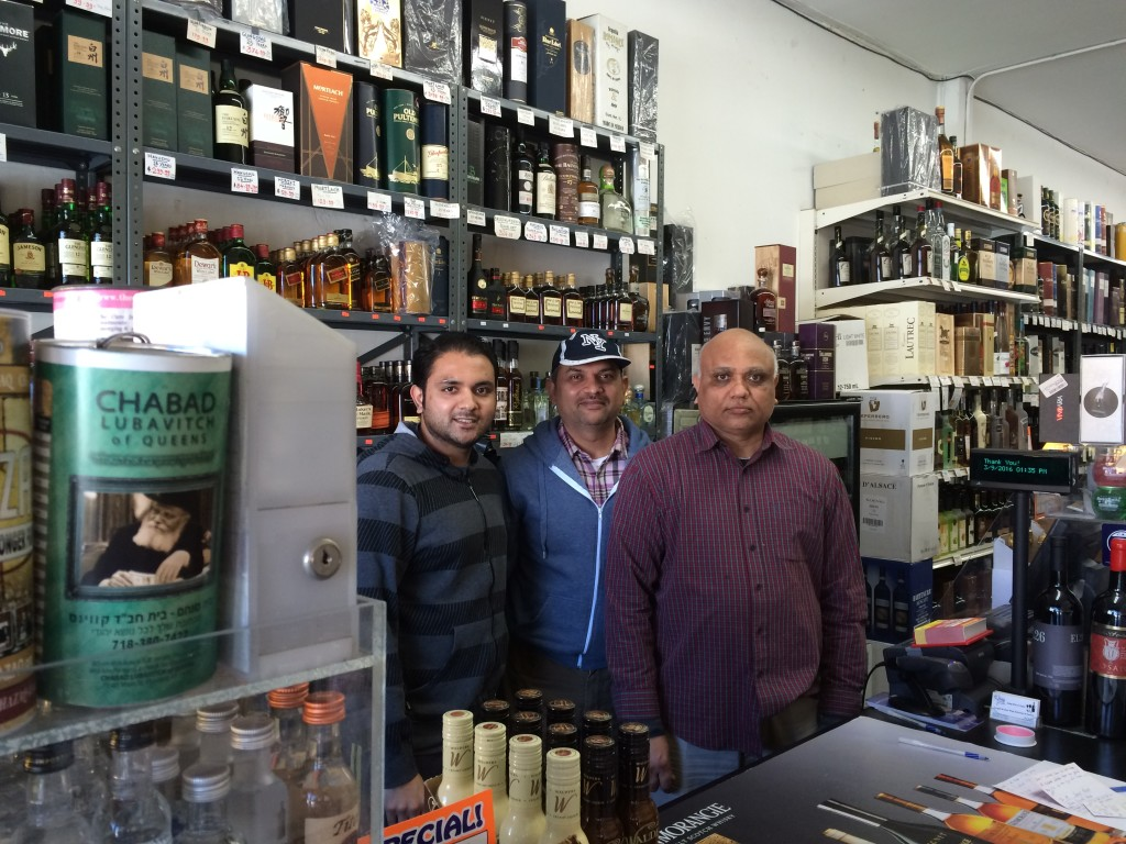 Samir Patel, left, with an associate and his father, right, says he gets about five requests each Saturday to act as a Shabbos goy for Orthodox Jews. (Uriel Heilman)