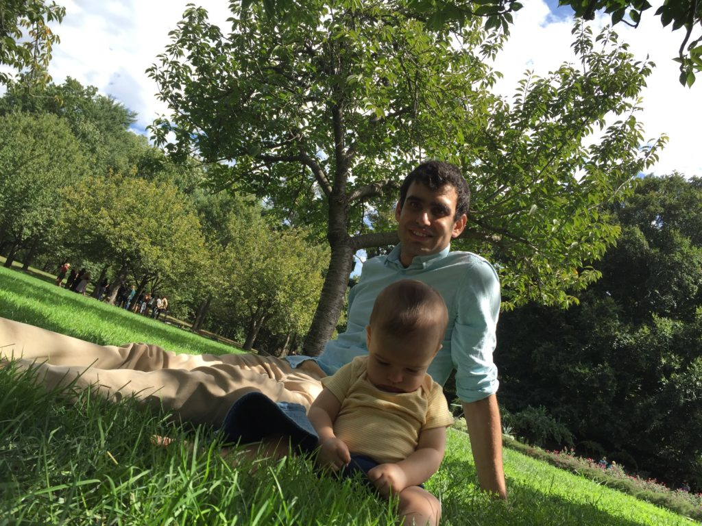JTA staff writer Ben Sales and his son relaxing at the Brooklyn Botanic Garden in September 2016. (Courtesy of Sales)