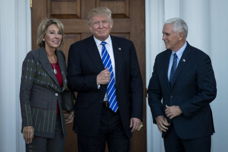 Betsy DeVos, President-elect Donald Trump and Vice President-elect Mike Pence outside the clubhouse at Trump International Golf Club in Bedminster Township, N.J., Nov. 19, 2016. (Drew Angerer/Getty Images)
