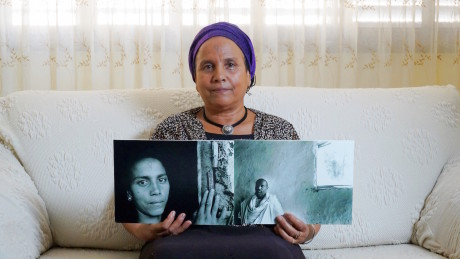 Abeba Brhan with a photo of her late husband, Ababa. (Beit Hatfutsot)