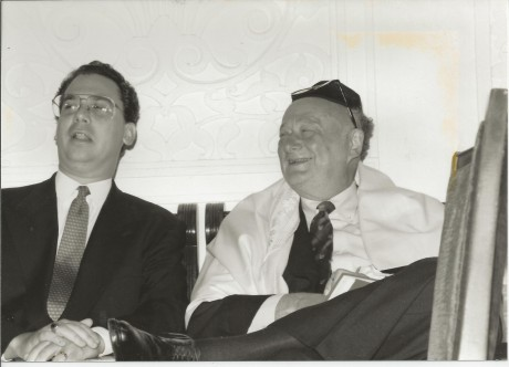 Former Mayor Ed Koch wearing a tallit and sitting with Rabbi Marc Schneier at Park East Synagogue following prayer services on the morning after his defeat in the Mayoral primary to David M. Dinkins, Sept. 12, 1989. (Foundation For Ethnic Understanding)