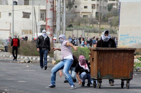 Palestinian protesters throwing stones outside Israel's Ofer military prison in the West Bank, near Ramallah, Feb. 25, 2013.  (Issam Rimawi/Flash90/JTA)