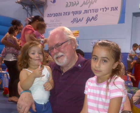 Congressman Ron Barber with children at a fortified indoor playground in Sderot, Israel, built with contributions from American groups and individuals. It can withstand a direct hit from a Gaza rocket. The area, under constant threat, is protected by the Iron Dome rocket interceptor. (Office of Congressman Ron Barber)